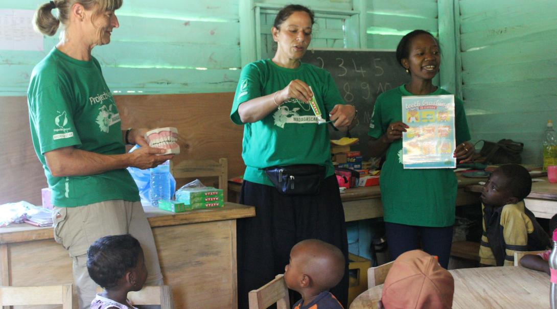 Older Projects Abroad volunteers teach a class to their students in Madagascar